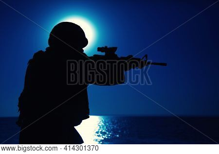 Silhouette Of Army Special Forces Rifleman, Soldier In Ammunition And Helmet Aiming Gun, Shooting Wi