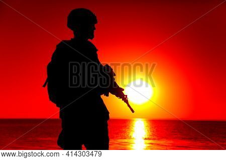 Silhouette Of Army Special Forces Rifleman, Marines, Coast Guard Or Anti-terrorist Squad Soldier In