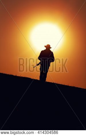 Silhouette Of Army Special Forces Soldier Armed With Service Rifle, Commando, Counter Terrorist Team
