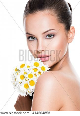 Face of young beautiful woman with posy flowers - isolated on white background