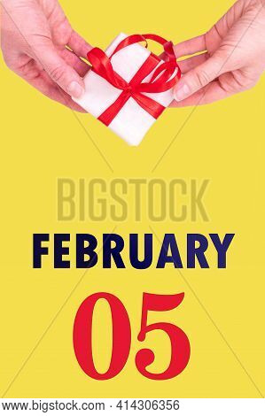 February 5th. Festive Vertical Calendar With Hands Holding White Gift Box With Red Ribbon And Calend