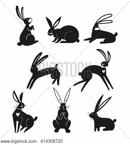 Silhouettes Of Black Rabbits Isolated On A White Background. Easter Bunnies In Vector Style. Silhoue