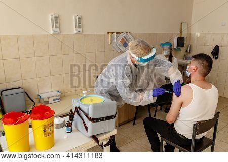 Uzhgorod, Ukraine - March 26, 2021: A Doctor Immunizes Veterans Of The Ukrainian Army Against Covid-