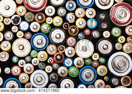 Dumped used batteries of various types (C AA AAA D 9V) collected for recycling - toxic waste and environmental issues concept