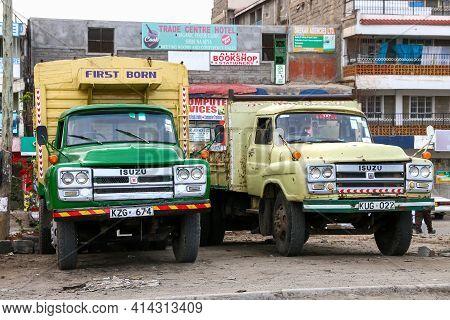 Nairobi, Kenya - February 9, 2021: Old Flatbed Trucks Isuzu Tx In The City Street.