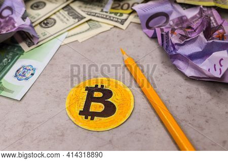 Paper Coin With Image Of Bitcoin On Gray Background. Crumpled Cash Notes Of Dollars And Euros Around