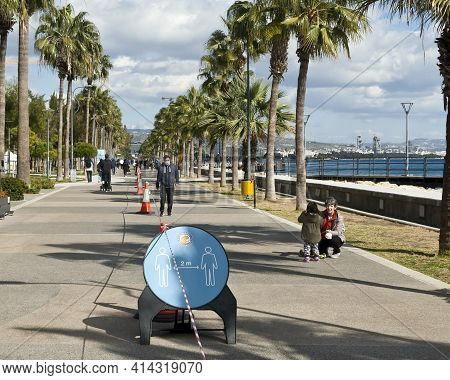 Limassol, Cyprus, January 29th, 2021: Social Distancing Signboard And Traffic Cones With Barricade T