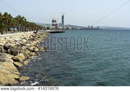 Limassol, Cyprus, March 9th, 2021: Seafront Promenade Molos With Palm Trees, Cityscape And Panoramic