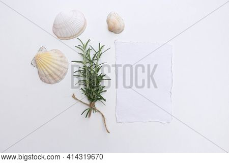 Feminine Scene With A Handmade Paper Greeting Card And Fresh Rosemary Sprigs Tied With Twine With Se