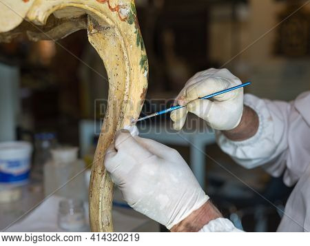 Parma, Italy - October 2020: Hands Of A Restorer With Gloves And Brush: Working On The Restoration O