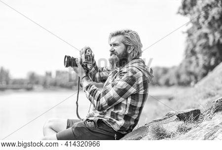 Spending Carefree Time. Hipster Man With Beard Use Professional Camera. Photographer Retro Camera. J