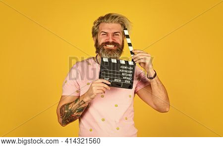 Bearded Man Hold Movie Clapper. Film Making Concept. Clapperboard Copy Space. Watch Movie. Film Dire