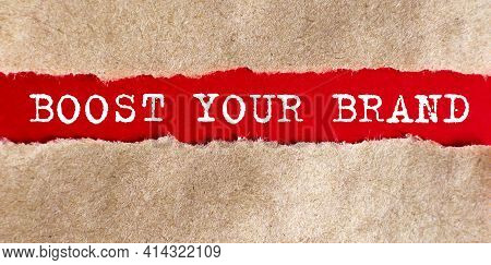Boost Your Brand. Word Written Under Torn Paper On The Red Background, Business