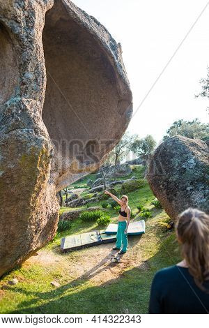 The Girl Shows The Route Along Which She Wants To Go. Rock Climbing In Nature. Bouldering On Rocks.