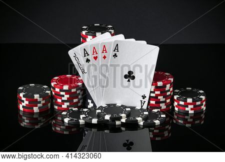 Poker Cards With Five Of A Kind The Highest Combination. Close-up Of Playing Cards And Chips In Poke