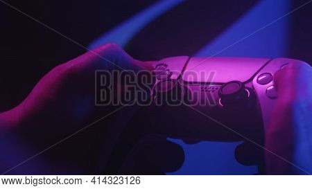 Gamer`s Playing A Game With A Gamepad Controller. Game Man Holding Simulator Joystick. Close Up. Hol