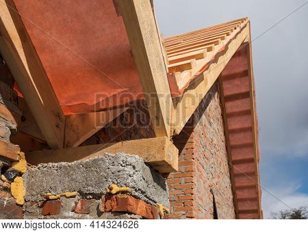 New Residential Construction Home Framing And Installation Of Wooden Beams At The Roof Truss System