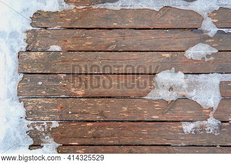 Abstract Texture Of Wooden Boards For Background With Surface Partially Covered With Ice And Snow