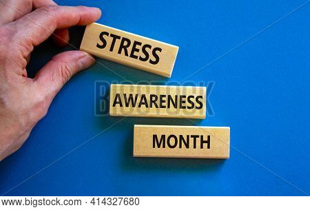 Stress Awareness Month Symbol. Wooden Blocks With Words 'stress Awareness Month'. Beautiful Blue Bac