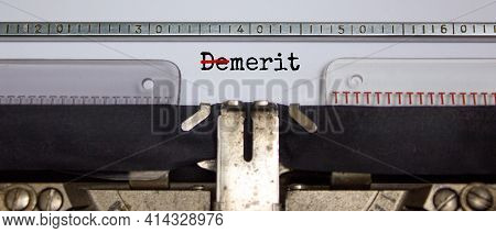 Demerit Or Merit Symbol. The Word 'demerit' Changed To 'merit' Typed On Retro Typewriter. Business,