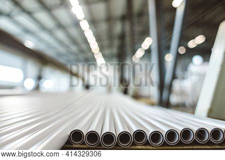 Warehouse Of Polypropylene Pipes. Workshop With Extruders For Producing Plastic Pipes. High Speed Ex
