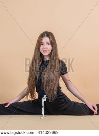 Cheerful Teen Girl Sit In Split, Stretching