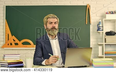 Providing Useful Information. Bearded Man Teach Information At School. Senior Teacher Use Laptop At