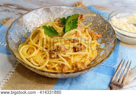 Creamy Italian Cuisine Spaghetti Alla Carbonara With Crumbled Sausage And Parsley Garnish