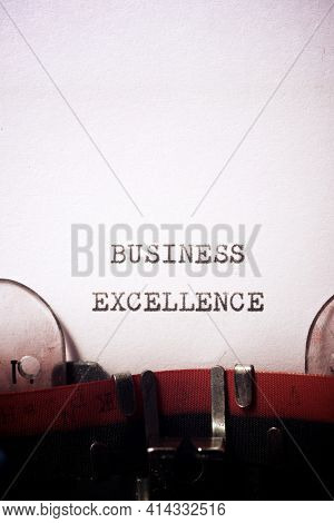 Business excellence phrase written with a typewriter.