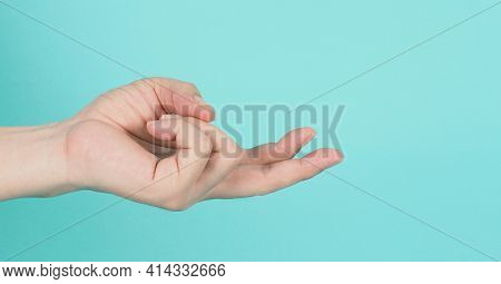 Empty Hand Holding Or Catch Nothing Guesture On Green And Blue Or Mint Background.