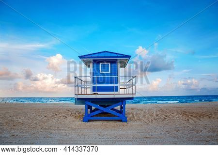 Beautiful Tropical Florida Landscape With Blue Lifeguard House At Sunset Twilight. American Beach Oc