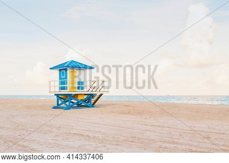 Beautiful Light Airy Tropical Florida Landscape With Blue Yellow Lifeguard House. American Florida B