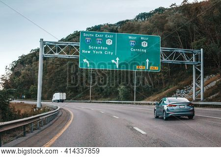 Cars On Highway In American Usa City Country. Road To New York City. Green Blue Street Signs To Ny C