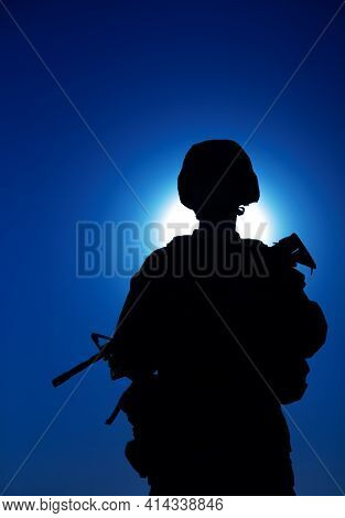 Silhouette Of Army Infantry Soldier Armed Assault Rifle On Background Of Night Sky With Moon. Specia