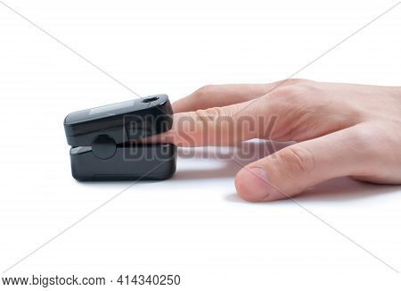 Pulse Oximeter On The Index Finger On A White Background. Measurement Of Blood Oxygen And Pulse. Iso