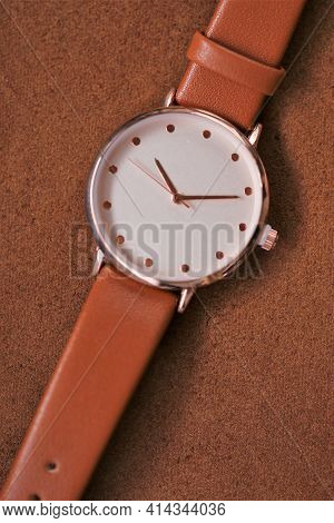 Watch With A Brown Leather Strap On A Brown Leather Background.genuine Leather Accessories. Clock An