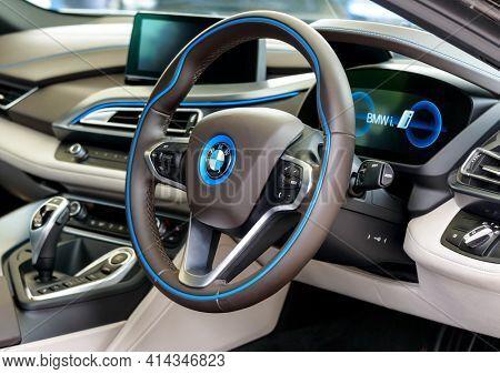 LONDON, UK - CIRCA JUNE 2014: BMW i8 dashboard. The BMW i8 is a plug-in hybrid sports car.