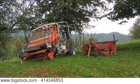 An Old And Obsolete Agricultural Machinery Standing On A Farm