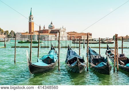 Historic Center Of Venice Against The Backdrop Of Gondolas Waiting For Tourists. Sea View Of Piazza