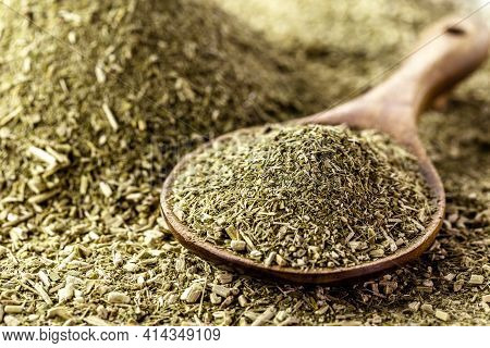 Wooden Spoon With Yerba Mate On Background With Herb
