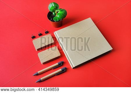 Photo Of Blank Kraft Stationery Set On Red Paper Background. Template For Branding Identity. Identit