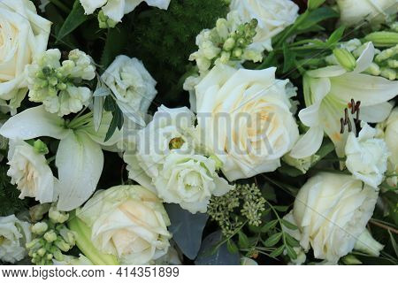 Big White Roses And Lilies In A Floral Wedding Arrangement