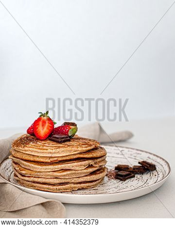 American Pancakes With Strawberries And Chocolate .. Stack Of Pancakes.breakfast.pancakes.