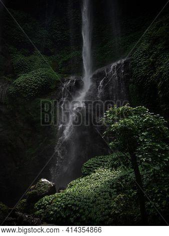Closeup Of Sekumpul Waterfall Cascade Cataract In Tropical Lush Green Jungle Rainforest Landscape Sa