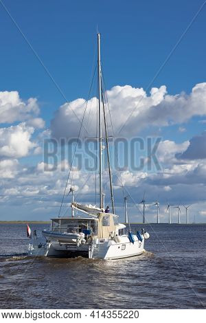 Urk, The Netherlands - March 19, 2021: Catamaran Sailing Ship At Dutch Sea Ijsselmeer Near Coast Wit