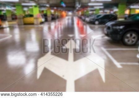 Parking Lot Blurred. Car Lot Parking Space In Underground City Garage. Empty Road Asphalt Background