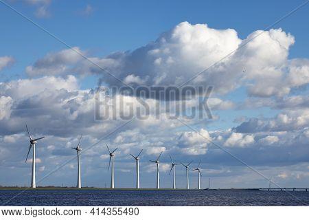 Dutch Coast With Big Wind Turbines And Beautiful Cloudy Sky