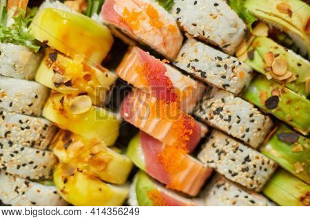 Different traditional sushi rolls background. Delicious japanese food.