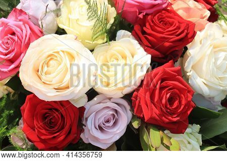 Flower Arrangement With Roses In Orange, Lilac, Red And White