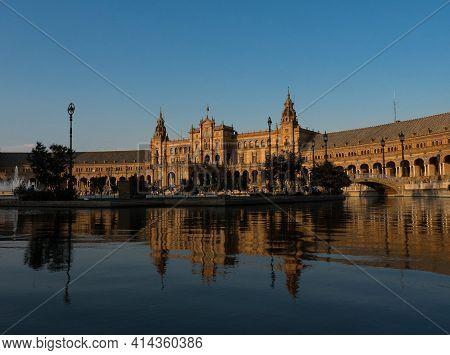 Plaza De Espana Spain Square Lake Water Pond Mirror Reflection Of Pavillon Building In Sevilla Andal